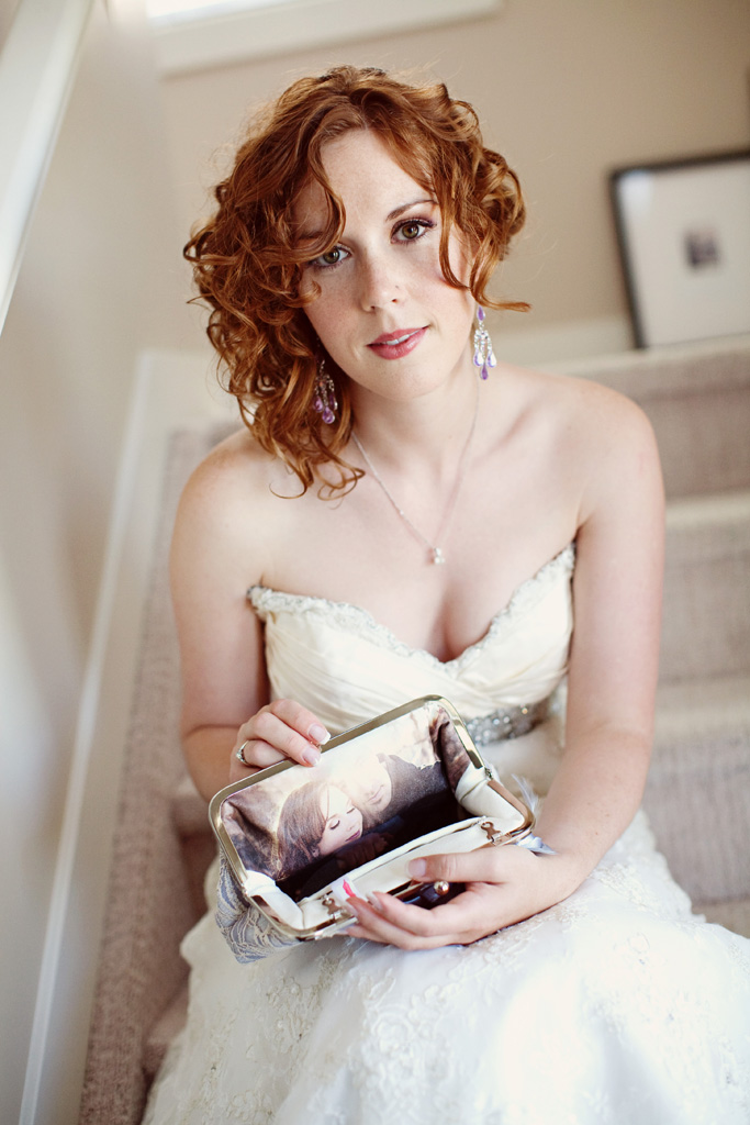 Bride holding a personalized photo lined clutch bag