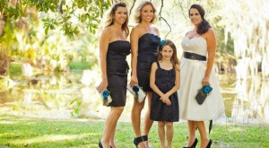 Bride and bridesmaids holding handmade ANGEE W. clutch bags